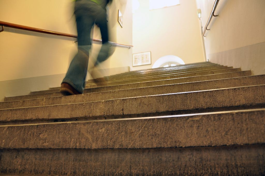 Female student running up the stairs